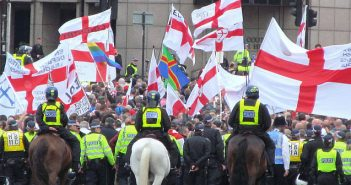 Far right protesters and police on horses