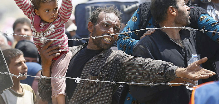 Refugees behind barbed wire