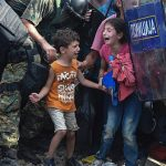 Refugees in Greece cordoned by police