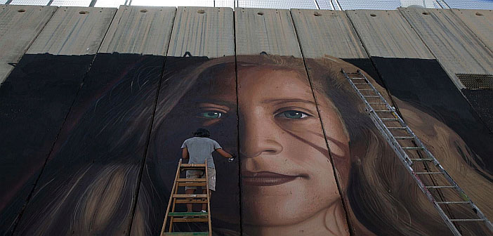 Painting of Ahed Tamimi on separation wall