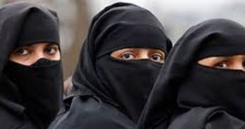 Three women wearing niqab