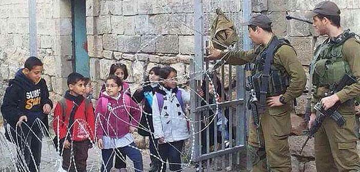 Palestinian school chidldren at checkpoint