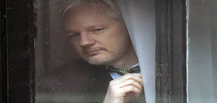 Julian Assange at Ecuodor Embassy window