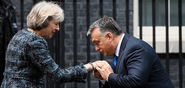 Victor Orban kisses Theresa May