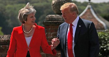 Theresa May and Donald Trump holding hands