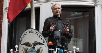 Julian Assange outside Ecuador Embassy